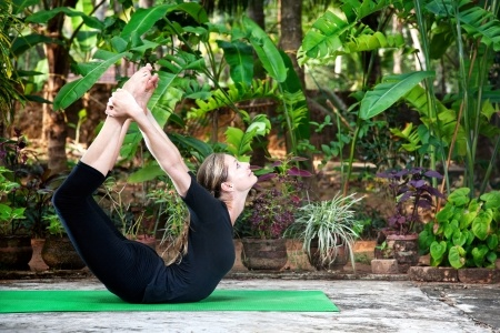 the guest teacher teaching yoga at ayurvedic healing village